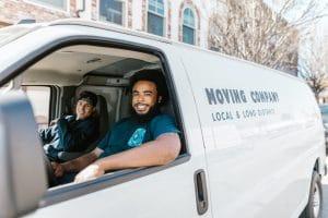 Movers inside their van
