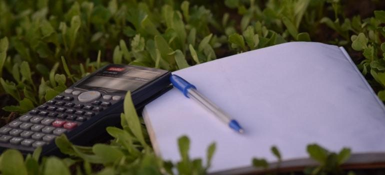 calculator and a notebook