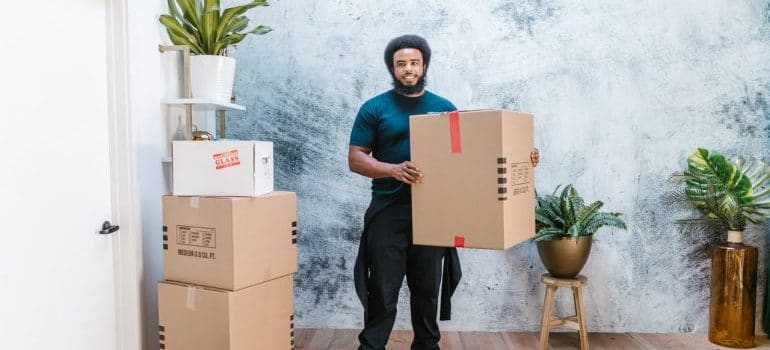 A mover following a guide to packing for a move