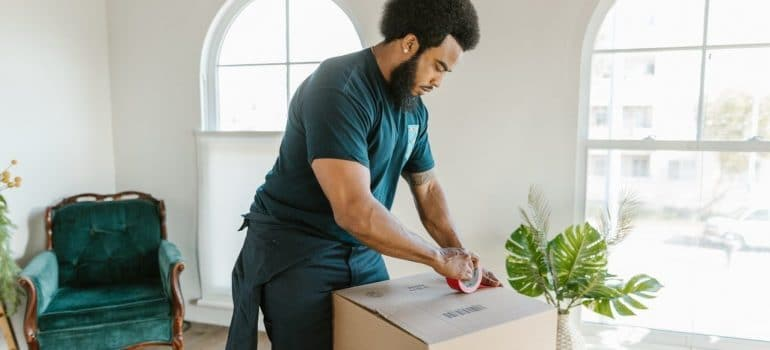 a man packing plants for moving
