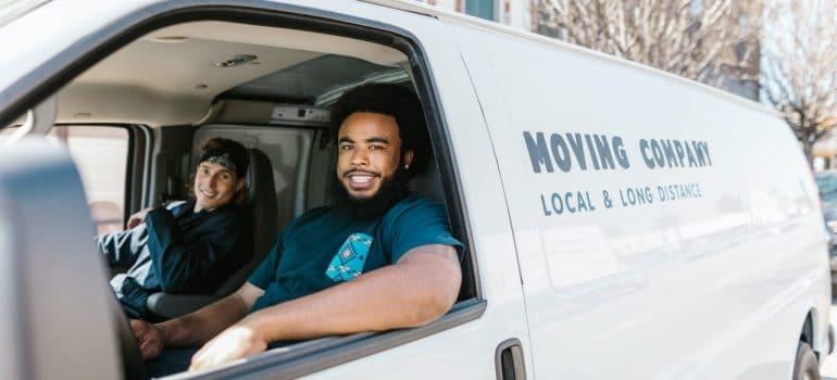 2 men sitting in a van