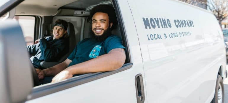 professional movers in a van