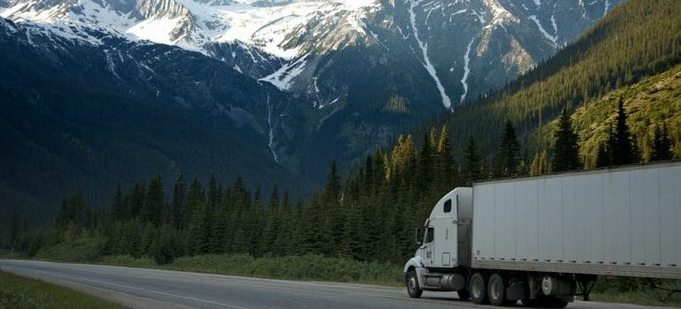 a truck on the road as a symbol of interstate moving tips