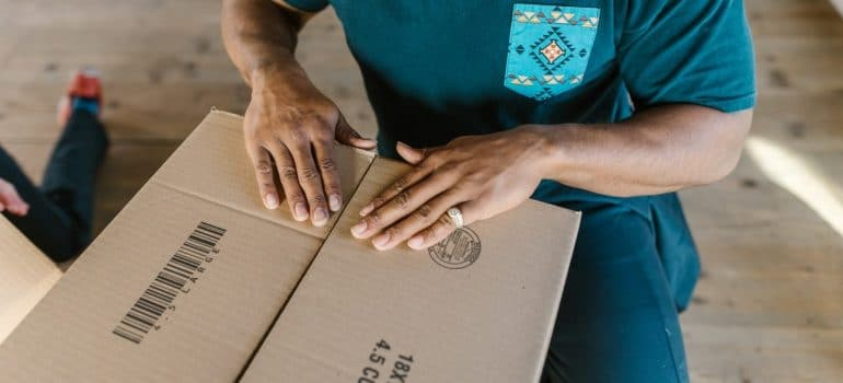 a professional mover packing a box