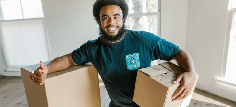 a mover smiling after giving tips for hiring movers
