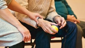 Elderly person squeezing a stress ball