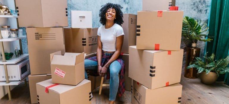 A girl among moving boxes