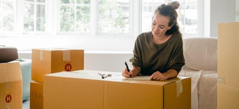 A woman creating a checklist.