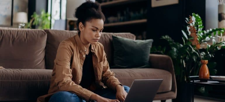 a woman looking something on a laptop