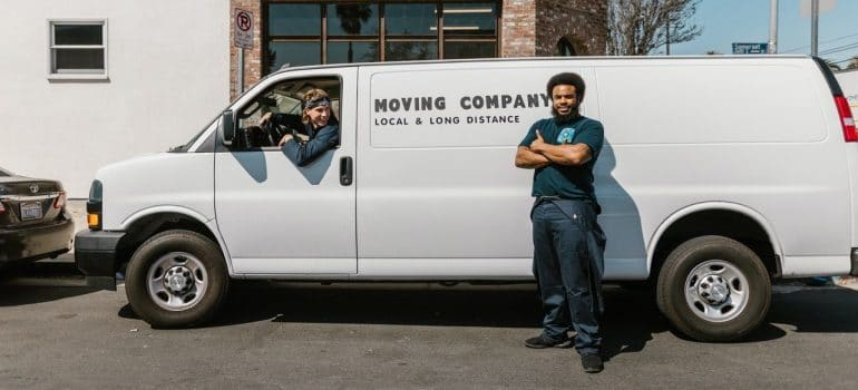 two moving company workers