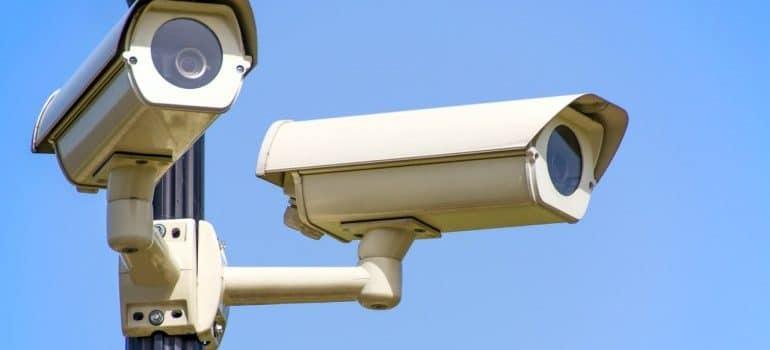 Two white CCTV cameras